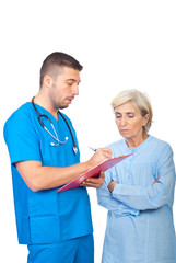 Doctor male write prescription for patient