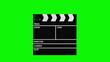 Movie production clapperboard isolated on green background