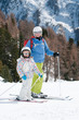 Little girl with mother on ski