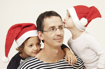 Father, sons and christmas cap