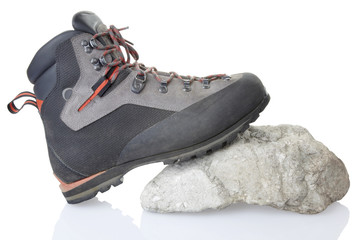 hiking boot on rock with clipping path