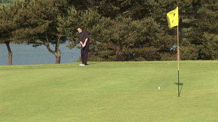 Golfer playing on the fifth hole