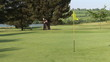 Golfer on the green doing the fourth hole
