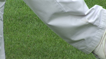 Close up of a golfer hitting the ball on a course