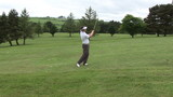 Golfer concentrating before hitting the ball
