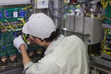 Skilled engineer working on computer hardware in a factory poster