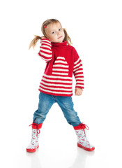 Little girl wearing sweater and gumboots