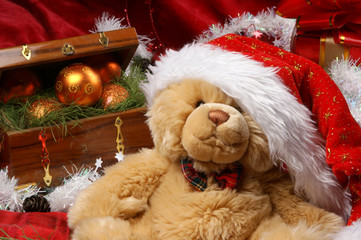 Christmas image of a teddy bear in a hat with presents