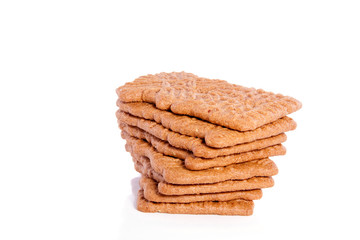 a stack of Dutch Speculaas cookies isolated on white background