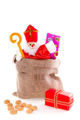 Dutch Sinterklaas celebration with present and gingernuts isolat