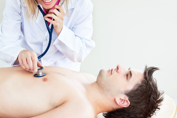 Close-up of a doctor feeling the breathing of a patient