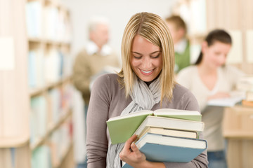 High school library - happy student with book