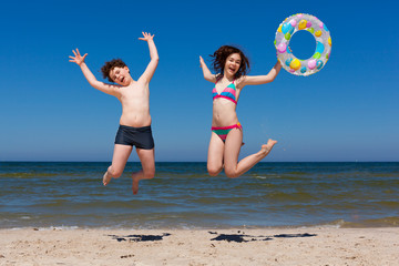 Kids jumping on beach