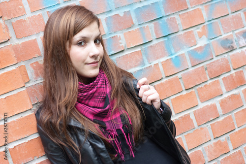 Girl waiting at brick wall 2