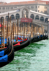 Gondolas on Grand Canal and Rialto Bridge in Venice.