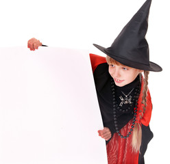 Child witch holding banner .