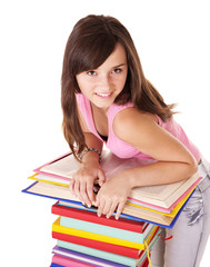 Girl with pile colored book .