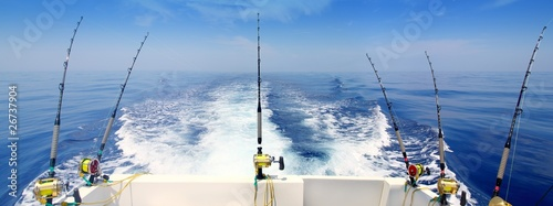 Leinwanddruck Bild boat fishing trolling panoramic rod and reels blue sea