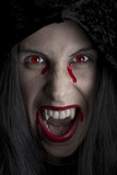 Cloaked female vampire up close. poster