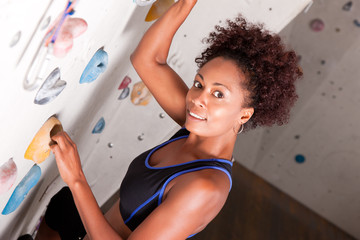 Woman at the climbing wall