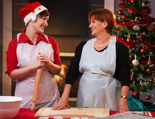 Mother and daughter baking at christmas