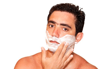 Young man shaving on a white background
