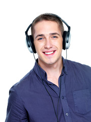 Happy man with headphones on head