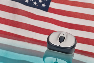 Computer Mouse with Reflection and Flag in Background