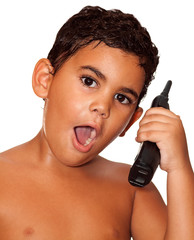 Small latin child with a phone on a white background