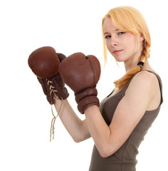 beautiful young woman in pair of boxing gloves