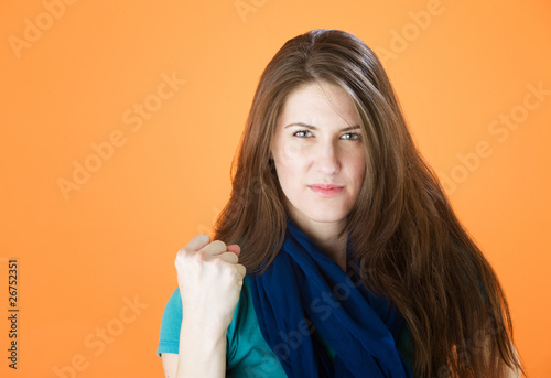 Pretty young woman making a fist