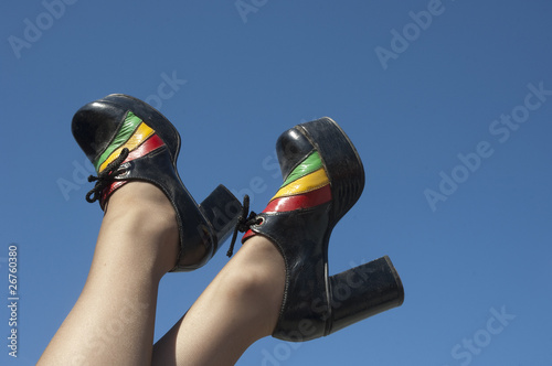 Pair of retro shoes with sky in the background