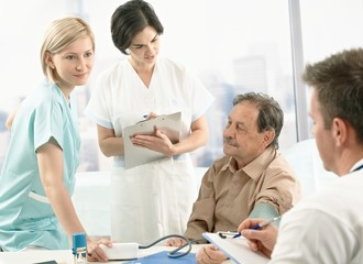 Medical team measuring blood pressure