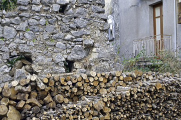 A stack of firewood near the wall in a bush-country