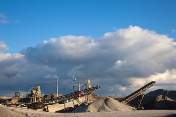 Conveyors and equipment at a quarry.