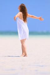 Young woman dancing at beach