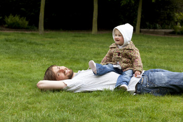 Happy father with child in the park