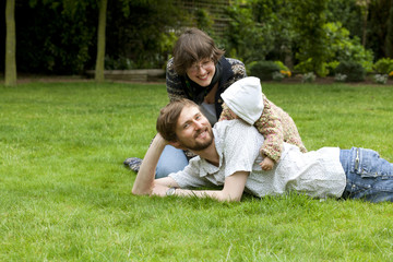 Happy family with child in the park