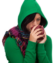 young woman in green sweatshirt keeping red cup