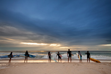 group of surfers preparing for their morning exercise