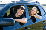 Fototapety happy young couple driving the car