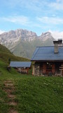 French chalet with surrounding moutains and blue sky