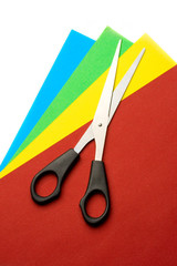 Colored papper and scissors isolated on white