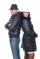 Fashionable couple in leather jackets and hats