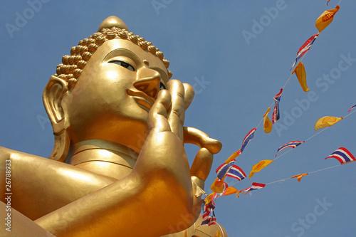 Golden Buddha. at Wat Khao Rang, Phuket, Thailand.