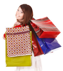 Girl holding group shopping bag. Isolated.