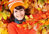 Fototapety Young woman in autumn orange leaves.