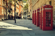 Street with a Tradicional Red Phone Boxes, London.
