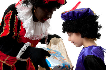 Zwarte Piet ( black pete) typical dutch character with young chi