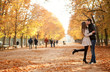 Young beautiful couple in the Luxembourg garden at fall. Paris,